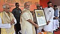 Narendra Modi at launch of the Deendayal Upadhyaya Gram Jyoti Yojana and various development projects, at Patna, Bihar. The Governor of Bihar, Shri Keshri Nath Tripathi, the Union Minister for Consumer Affairs.jpg