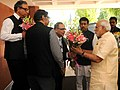 Narendra Modi being welcomed by the Secretary I&B, Shri Bimal Julka on his arrival at the launching ceremony of DD Kisan Channel, in New Delhi. The Minister of State for Information & Broadcasting.jpg