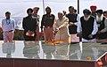 Narendra Modi paying homage at the samaadhi of 'Punjab Mata' (mother of Shaheed Bhagat Singh), at Hussainiwala, in Punjab. The Chief Minister of Punjab, Shri Parkash Singh Badal.jpg