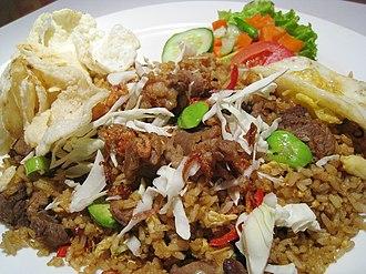 Nasi goreng - Nasi goreng with green stinky beans and goat meat in Jakarta.
