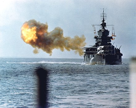 The battleship USS Idaho shelling Okinawa on April 1, 1945 New Mexico class battleship bombarding Okinawa.jpg
