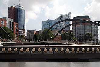 HafenCity - High-rises of the Hanseatic Trade Center around the Kehrwiederspitze; Elbphilharmonie visible in the background.