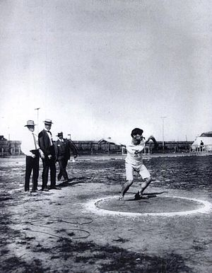 Athletics at the 1904 Summer Olympics – Men's discus throw - Nikolaos Georgantas throwing the discus on the way to finishing with the bronze.