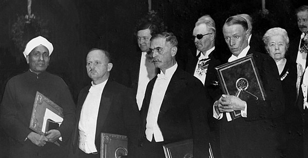 Raman at the 1930 Nobel Prize Award Ceremony with other winners, from left C. V. Raman (physics), Hans Fischer (chemistry), Karl Landsteiner (medicine) and Sinclair Lewis (literature) Nobel ceremony 1930.jpg
