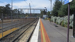 Hurstbridge railway station - Northbound view in November 2015. A derailed train is visible in the distance.