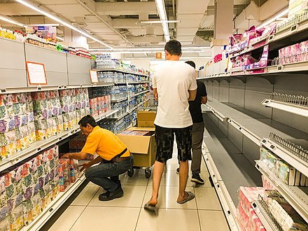 Coronavirus fears lead to panic buying of essentials in Singapore Ntuc super store, Singapore (49505410793).jpg