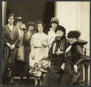 Anita Pollitzer - Photograph of (left to right) Alice Paul, Sue White, Florence Boeckel, Anita Pollitzer (center, holding hat), Mary Winsor, Sophie Meredith, and Mrs. Richard Wainwright of the National Woman's Party standing on front steps in front of new national headquarters building, across from the U.S. capitol in May 1922