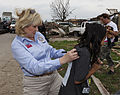 Oklahoma Gov. Mary Fallin, left, signs a Plaza Towers Elementary School student's t-shirt during a tour of the school in Moore, Okla., May 28, 2013, where seven students were killed during a tornado May 20 130528-Z-VF620-4792.jpg