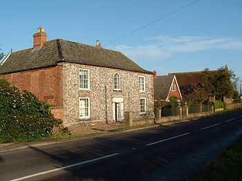 English: Old house with flint front wall, John...
