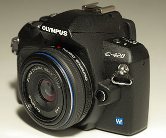 "Four Thirds system - An Olympus E-420 camera, sold with a very thin 25mm ""pancake"" lens. The E-4XX series was advertised as the smallest true DSLR in the world."