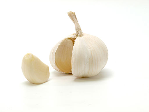 Opened garlic bulb with garlic clove