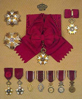 Order of the Crown (Belgium) - Top left: Grand Cross' star, middle left: Grand Officer plaque, top center: Grand Cross' sash, top right: Commander's cross, bottom, from left to right: Officer's cross, Knight's cross, Gold Palms, Silver Palms, Gold Medal, Silver Medal, Bronze Medal (courtesy Société de l'Ordre de Léopold)