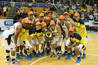 Michigan Wolverines - Michigan team with championship trophy at the 2011 Paradise Jam Tournament
