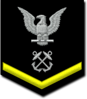 Petty officer third class - U.S. Navy petty officer third class sleeve rating badge for a boatswain's mate, with a gold chevron, denoting good conduct variation.