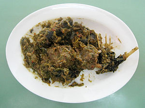 Bat as food - Paniki prepared with fruit bat meat cooked in spicy rica green chili pepper. An exotic Manado (Minahasan) dish. Manado, North Sulawesi, Indonesia.
