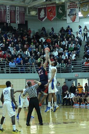 Illinois High School Association - Jabari Parker (white) and Jahlil Okafor (blue) during opening jump ball in March 8, 2013 IHSA sectional championship