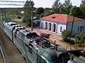 Pella station blue house and ES4K locomotive.jpg