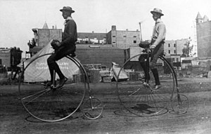 Penny-farthing - Two men ride penny-farthings in Santa Ana, California, 1886