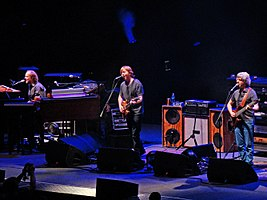 Phish performing live at American Airlines Arena in Miami in 2009. Left to right: Page McConnell, Trey Anastasio, and Mike Gordon.