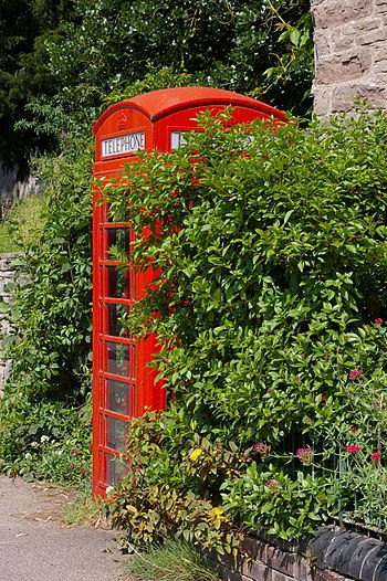 English: Phone box A rare sight these days, an...