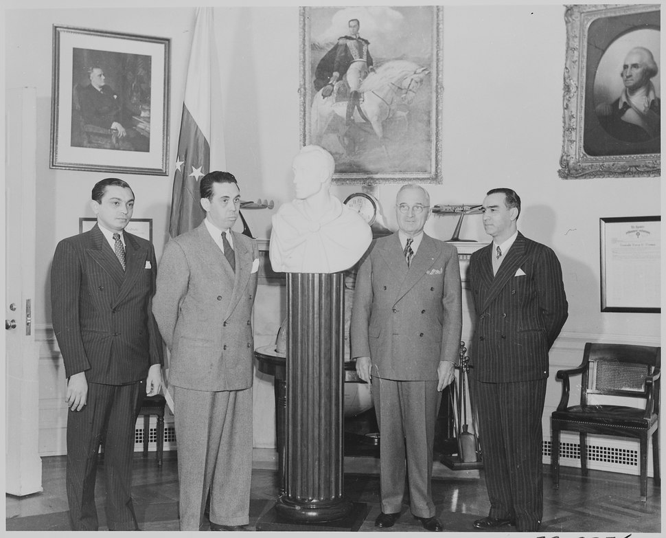 Photograph of President Truman receiving a marble bust of Simon Bolivar from a Venezuelan delegation in the Oval... - NARA - 199531.tif