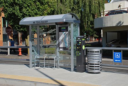 The amenities at each streetcar stop include a small shelter (with interior information display), ticket vending machine and trash can. Portland Streetcar stop, 7th & Halsey, Sep. 2012.jpg