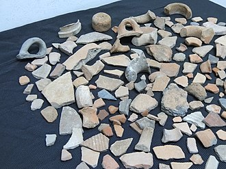 Sherd - Collection of potsherds and loom weight taken from different ruins.