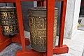 Prayer wheels in Lama Temple (7971094980).jpg