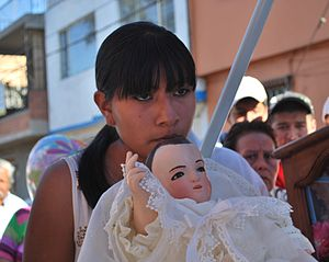 Child Jesus images in Mexico - The Niñopa held by a girl during a procession in Xochimilco