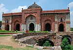 Purana Quila (Inderpat) or Delhi With all its walls Arcades, gateways and Bastions, gardens, the Mosque of Sher Shah (Kila Kohna Masjid - Qila-i-Kuhna mosque). The Sher Mandala and entrances to Subterranean passages.