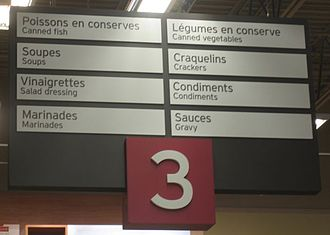 Bilingual sign - Bilingual sign in a Quebec supermarket with markedly predominant French text