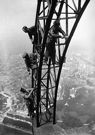 Repainting the Eiffel Tower in 1924.