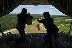 RAAF loadmasters drop two heliboxes from the back of a C-130J in April 2016.jpg
