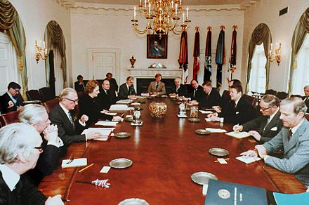 Thatcher and her cabinet meeting with the Reagan cabinet in the White House Cabinet Room, 1981 Reagan-Thatcher cabinet talks.jpg