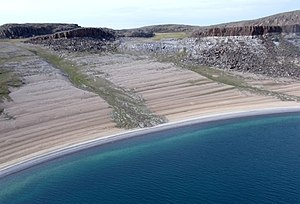 Post-glacial rebound - This layered beach at Bathurst Inlet, Nunavut is an example of post-glacial rebound after the last Ice Age.  Little to no tide  helped to form its layer-cake look. Isostatic rebound is still underway here.