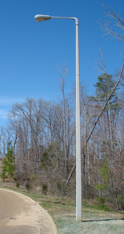 Reinforced concrete street light pole. Concrete poles are less expensive than traditional steel or aluminium poles and may outlast them.