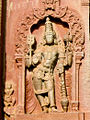 Relief of deity holding attributes and blessing devotees in Aghoreshwara temple at Ikkeri (2).jpg