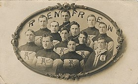 A postcard of an early ice hockey team. The players are shown from the waist up and wear a sweater with the team's logo.