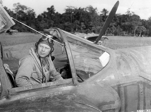 Major Richard Bong, the top flying ace in the war, credited with shooting down 40 Japanese aircraft in his P-38 Lightning Richard Bong in cockpit.jpg