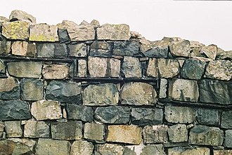 Hardknott Roman Fort - On many walls a slate layer demarcates original Roman construction (below) and Victorian reconstruction (above)