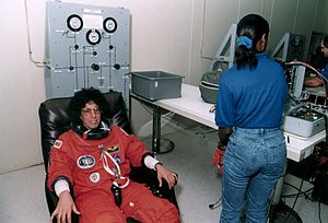 Ellen S. Baker - Baker suiting up prior to STS-71 launch.