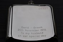 A modern engraved hip flask