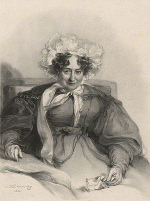 Image of a lady, aged 75, sitting up in her bed