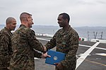 Sailor receives an award 150312-M-CX588-082.jpg