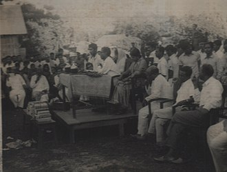 Singranatore family - Members of the Singranatore family (seated center) holding a council meeting (Durbar) with the common people in estate of Natore, in erstwhile East Pakistan after the State Acquisition Legislature