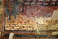 San lorenzo in insula, cripta di epifanio, affreschi di scuola benedettina, 824-842 ca., martirio di san lorenzo 04 fiorellini.jpg
