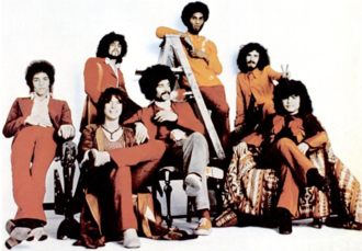 "Santana (band) - Santana in 1971. L-R: Neal Schon, Gregg Rolie, Michael Shrieve, Michael Carabello, David Brown, Carlos Santana, and José ""Chepito"" Areas"