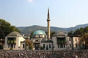 Emperor's Mosque - Pedestrians walk by the Emperor's Mosque, the oldest mosque in Sarajevo.