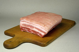 Pork - Pork belly cut, shows layers of muscle and fats.