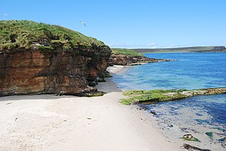 Eday - One of Eday's beaches, with sea caves adjacent to the southern end of Calf Sound